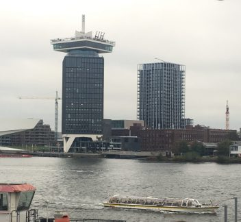 People Swinging off I am Amsterdam Tower. Scary!