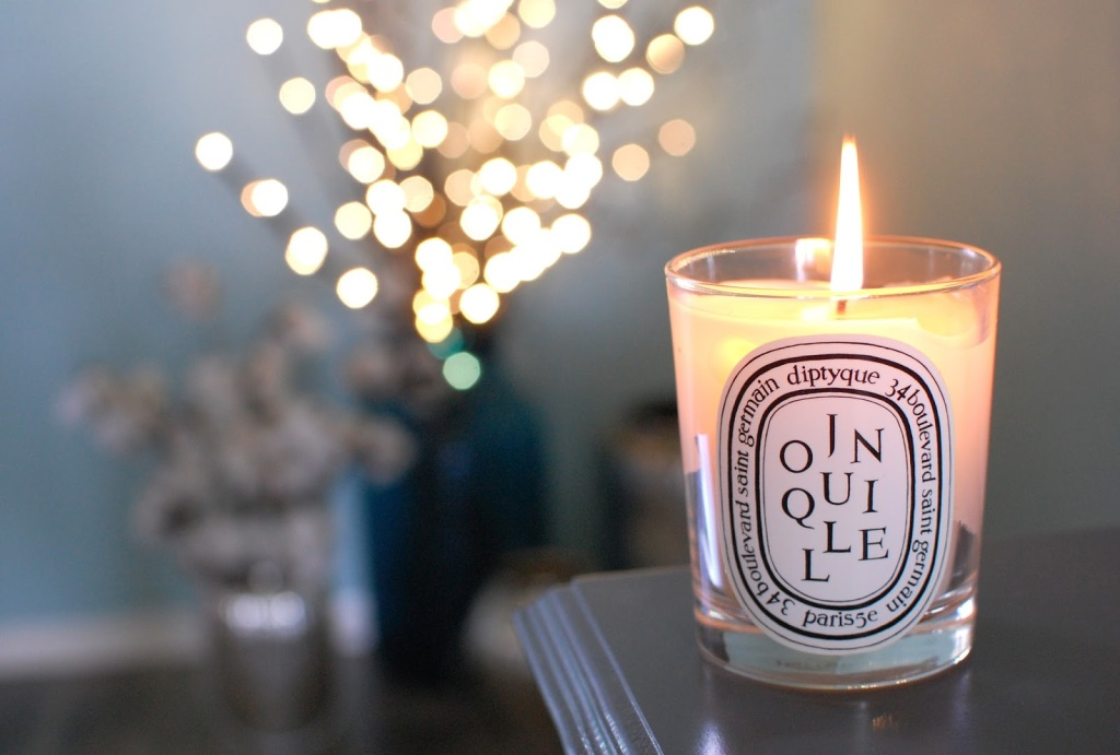 diptyque candle in the foreground